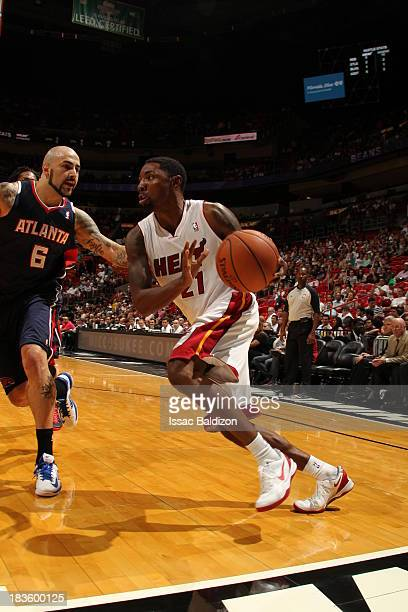 Roger Mason Jr #21 of the Miami Heat drives baseline against the Atlanta Hawks during a game on October 7 2013 at American Airlines Arena in Miami...