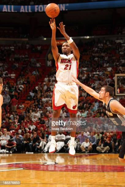 Roger Mason Jr #21 of the Miami Heat shoots the jump shot against the San Antonio Spurs during a game on October 19 2013 at American Airlines Arena...