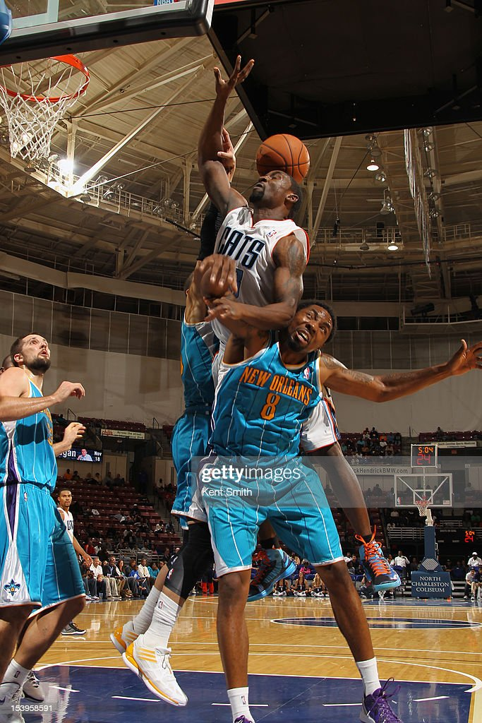 Roger Mason #8 of the New Orleans Hornets attempts to block a shot from Ben Gordon #8 of the Charlotte Hornets at the North Charleston Coliseum on October 11, 2012 in North Charleston, South Carolina.
