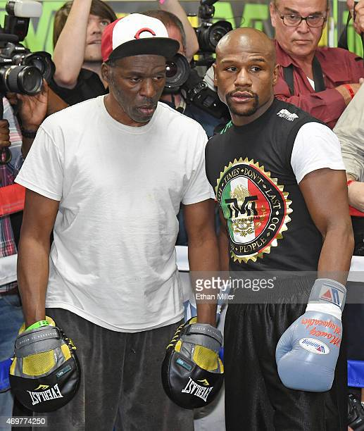 Roger Mayweather and his nephew WBC/WBA welterweight champion Floyd Mayweather Jr talk during a workout at the Mayweather Boxing Club on April 14...