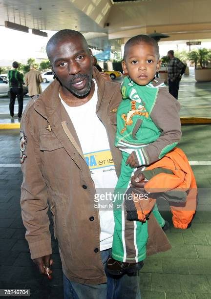 Roger Mayweather uncle and trainer of boxer Floyd Mayweather Jr arrives with his twoyearold son Lehkei Mayweather at the MGM Grand Hotel/Casino...