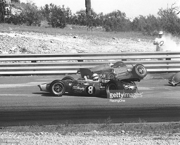 Roger McCluskey tangles with Johnny Rutherford during the Jimmy Bryan Memorial 150 USAC Indy Car race at Phoenix International Raceway