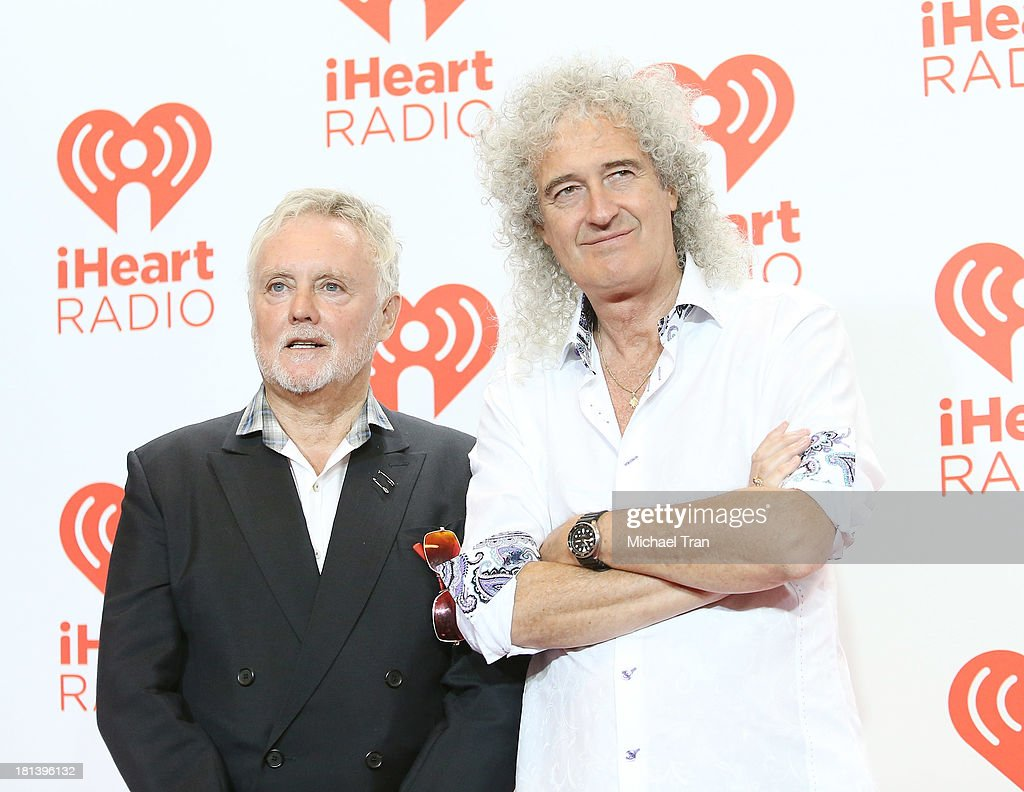 Roger Meddows Taylor (L) and Brian May of Queen arrive at the iHeartRadio Music Festival - press room held at MGM Grand Arena on September 20, 2013 in Las Vegas, Nevada.