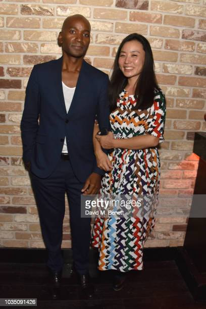 Roger Michael and Edeline Lee attend the Edeline Lee X Glass Magazine party during London Fashion Week September 2018 at Kadie's Cocktail Bar Club on...