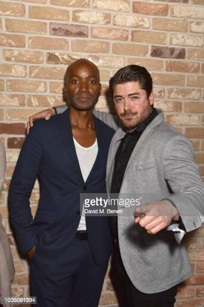 Roger Michael and Kyle James attend the Edeline Lee X Glass Magazine party during London Fashion Week September 2018 at Kadie's Cocktail Bar Club on...