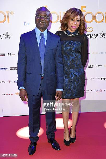 Roger Milla and Stephanie Milla attend the Golden Foot 2014 Awards Ceremony at Sporting Club on October 13 2014 in MonteCarlo Monaco