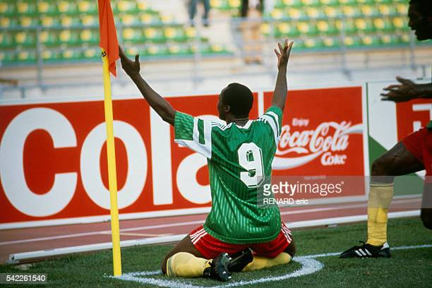 Roger Milla celebrates scoring a goal during a first round match of the 1990 FIFA World Cup against Romania Cameroon won 21