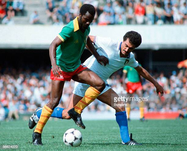 Roger Milla of Cameroon and Claudio Gentile of Italy in action during the World Cup match between Italy and Camerun on June 23 1982 in Vigo Spain