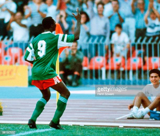 Roger Milla of Cameroon celebrates scoring his first goal during the World Cup eighth final match between Cameroon and Colombia at the San Paolo...