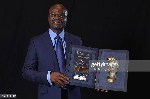 Roger Milla poses with the Golden Foot award during the Golden Foot 2014 Awards Ceremony at Sporting Club on October 13 2014 in MonteCarlo Monaco