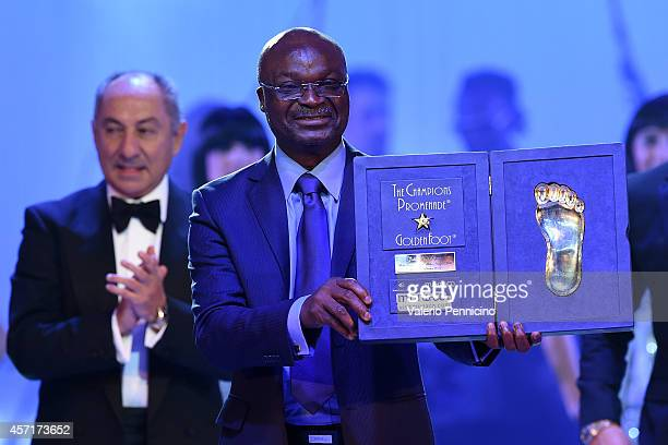 Roger Milla receives the Golden Foot Award trophy during the Golden Foot Award 2014 ceremony at Sporting Club on October 13 2014 in MonteCarlo Monaco
