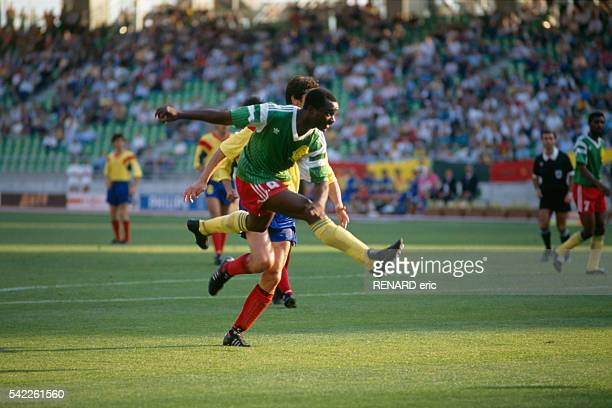 Roger Milla scoring a goal during a first round match of the 1990 FIFA World Cup against Romania Cameroon won 21