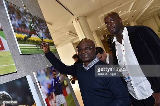 Roger Milla signs a picture after the Golden Foot Award press conference at Grimaldi Forum on October 10 2014 in MonteCarlo Monaco