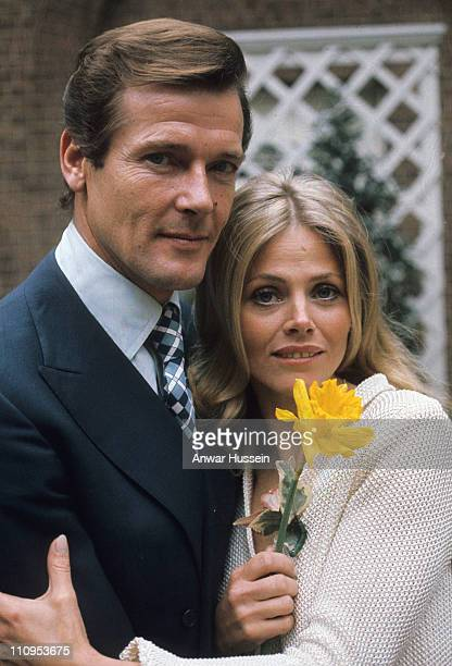 Roger Moore and Britt Ekland pose on location for the filming of James Bond film 'The Man With The Golden Gun' on April 1 1974 in London England