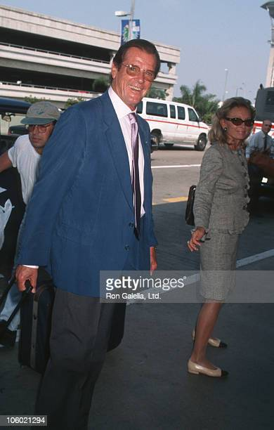 Roger Moore and Christina Tholstrup during Roger Moore and Christina Tholstrup Sighted at Los Angeles International Airport at Los Angeles...