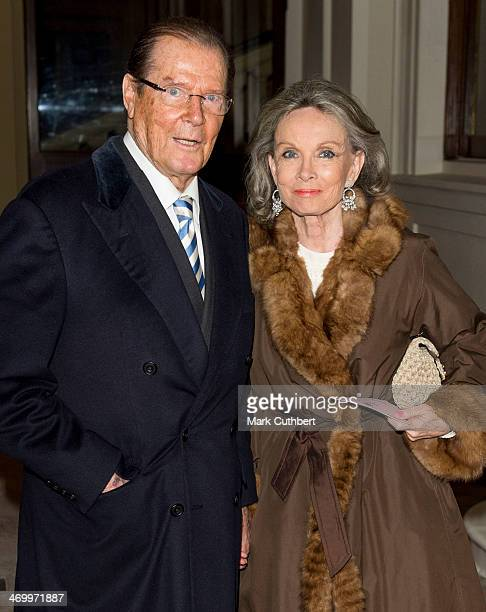 Roger Moore and Kristina Tholstrup attend a Dramatic Arts Reception at Buckingham Palace on February 17 2014 in London England