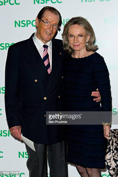 Roger Moore and Kristina Tholstrup attends A Night Out With Michael Caine at Royal Albert Hall on October 1 2014 in London England