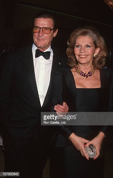 Roger Moore and Luisa Moore during AFI Life Achievement Award Honoring Sidney Poitier at Beverly Hilton Hotel in Beverly Hills California United...