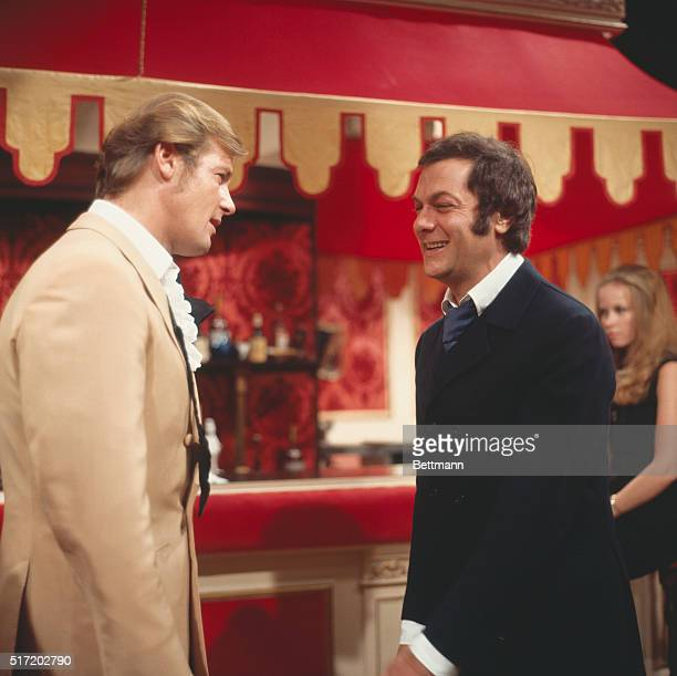 Roger Moore and Tony Curtis talking together in this still from the TV series The Persuaders which aired from 19711972