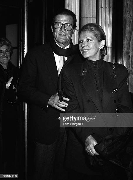 Roger Moore and wife Louisa at Langan's Brasserie on December 5, 1987 in London, England.