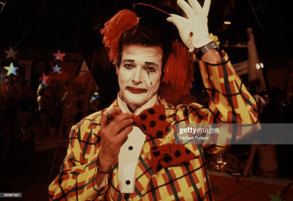 Roger Moore dressed as a clown on the set of the James Bond movie 'Octopussy', Pinewood Studios, 1983.