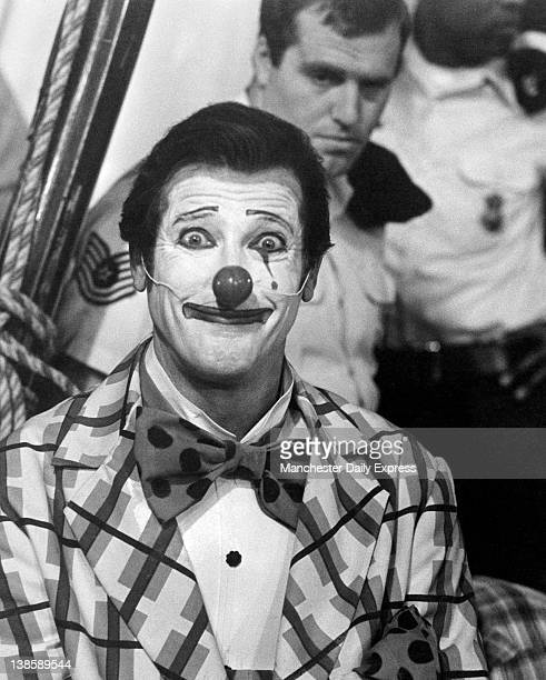 Roger Moore for somewhere along the way 007 swopped his cashmere suit and sharkskin shoes for a clown's outfit But it was all in the cause of saving...