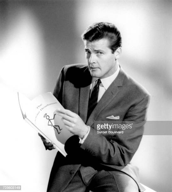 Roger Moore in a promotional portrait for the TV series 'The Saint' October 1962 He is holding the script of the Series 1 episode 'The Covetous...
