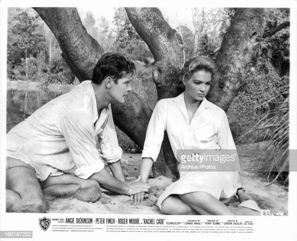 Roger Moore leaning towards Angie Dickinson in a scene from the film 'The Sins Of Rachel Cade' 1961