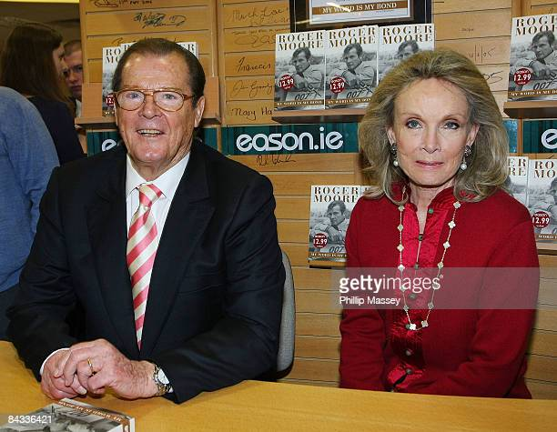 Roger Moore signs copies of his book 'My Word Is My Bond' with his wife Christina Tholstrup in Easons on January 17 2009 in Dublin Ireland