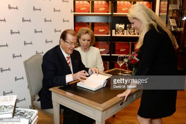 """Roger Moore signs copies of his new book """"Last Man Standing: Tales from Tinseltown"""" alongside wife Kristina Tholstrup at Harrods Bookshop on..."""