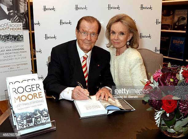 Roger Moore signs copies of his new book Last Man Standing Tales from Tinseltown alongside wife Kristina Tholstrup at Harrods Bookshop on September...