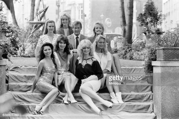 Roger Moore star of the new James Bond film 'Octopussy' today met the press accompanied by the glamorous girls from the film Janine Andrews Joni...