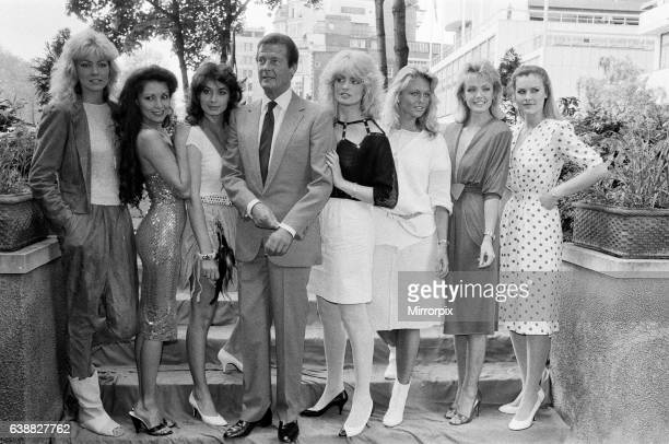 Roger Moore star of the new James Bond film 'Octopussy' today met the press accompanied by the glamorous girls from the film LR Janine Andrews Joni...