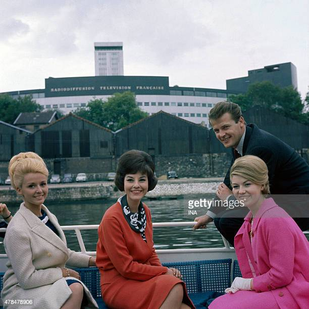 Roger Moore together with the announcers Michele Demai and Denise Fabre in walk on the Seine in front of the house of the ORTF