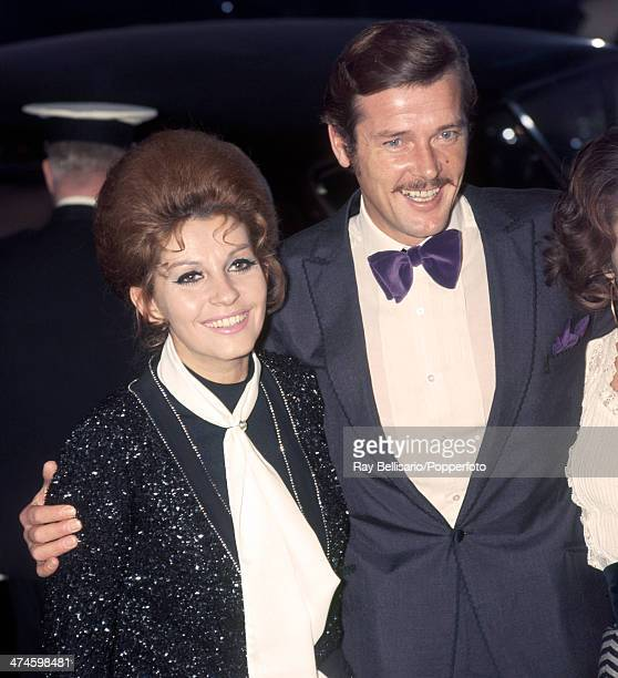 Roger Moore with his wife Luisa Mattioli at a film premiere in London circa 1970