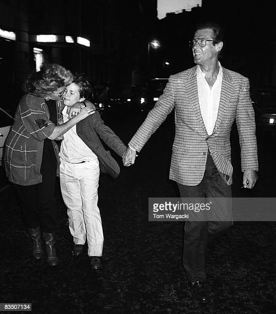 Roger Moore with wife Louisa and son Christian at Langan's Brasserie circa 1985 in London, England.