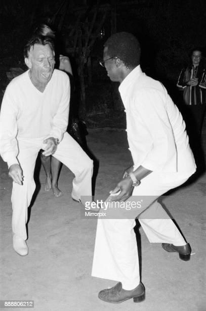 Roger Moore's 50th Birthday Party in the bush near Tshipise South Africa during the filming of his latest film 'Wild Geese' Richard Burton dancing...