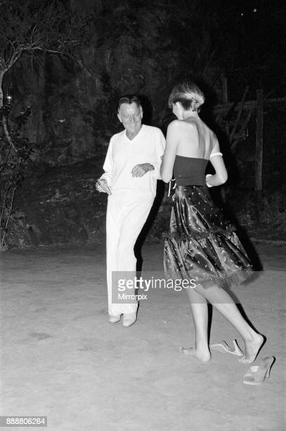 Roger Moore's 50th Birthday Party in the bush near Tshipise South Africa during the filming of his latest film 'Wild Geese' Richard Burton dances...