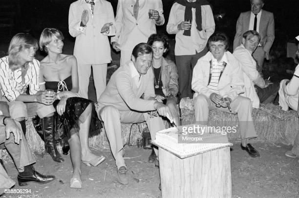 Roger Moore's 50th Birthday Party in the bush near Tshipise South Africa during the filming of his latest film 'Wild Geese' Roger is pictured with...