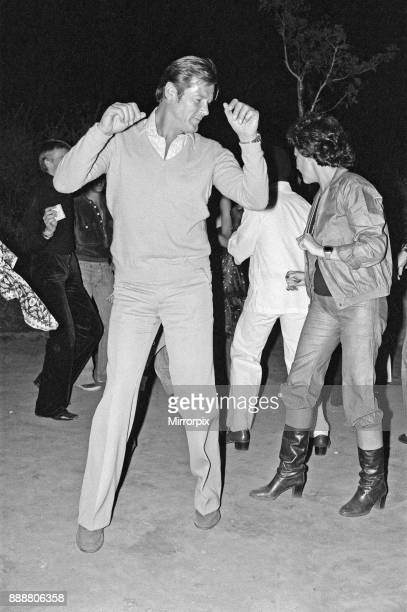 Roger Moore's 50th Birthday Party in the bush near Tshipise South Africa during the filming of his latest film 'Wild Geese' Roger is pictured dancing...