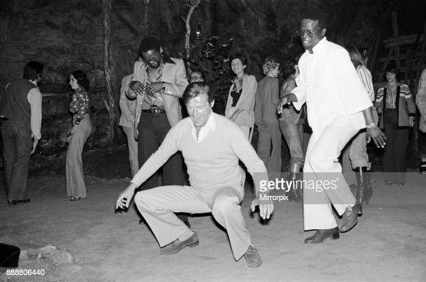 Roger Moore's 50th Birthday Party in the bush near Tshipise South Africa during the filming of his latest film 'Wild Geese' 18th October 1977