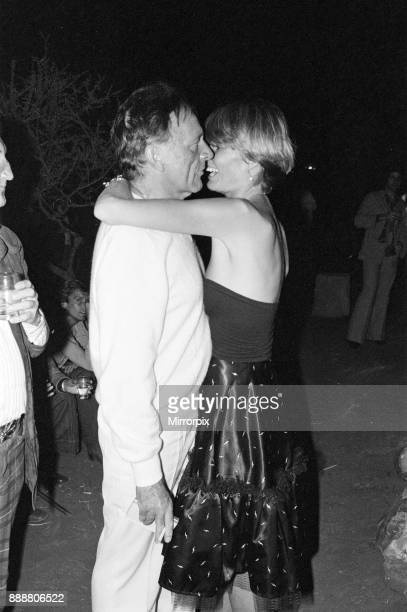 Roger Moore's 50th Birthday Party in the bush near Tshipise South Africa during the filming of his latest film 'Wild Geese' Richard Burton and his...