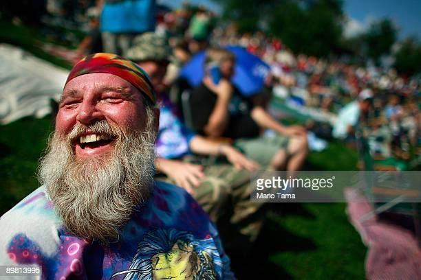 Roger Morris laughs as he waits for the start of the concert marking the 40th anniversary of the Woodstock music festival August 15 2009 in Bethel...