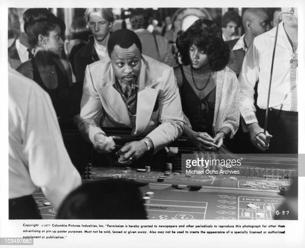 Roger Mosley gambles at craps table in a scene from the film 'The Greatest' 1977