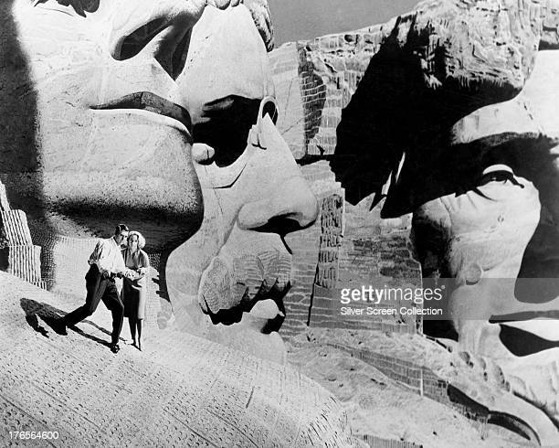 Roger O Thornhill played by Cary Grant and Eve Kendall played by Eva Marie Saint make their escape onto Mount Rushmore in 'North by Northwest'...