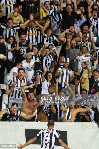 Roger of Brazil's Botafogo celebrates with supporters after scoring against Argentinas Estudiantes de La Plata during their Copa Libertadores 2017...