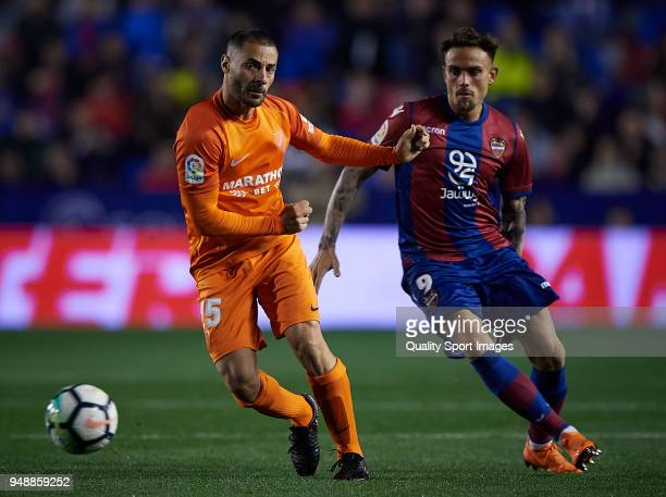 Roger of Levante competes for the ball with Medhi Lacen of Malaga during the La Liga match between Levante and Malaga at Ciutat de Valencia Stadium...