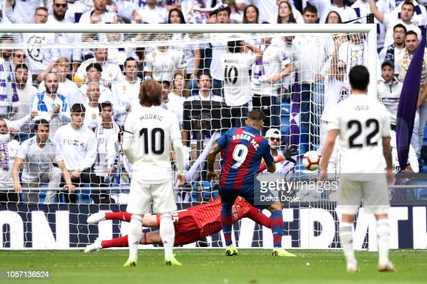 Roger of Levante scores his sides second goal from the penalty spot during the La Liga match between Real Madrid CF and Levante UD at Estadio...
