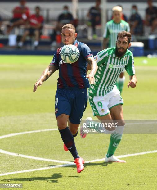 Roger of Levante UD battles for possession with Borja Iglesias of Real Betis Balompie during the La Liga match between Levante UD and Real Betis...