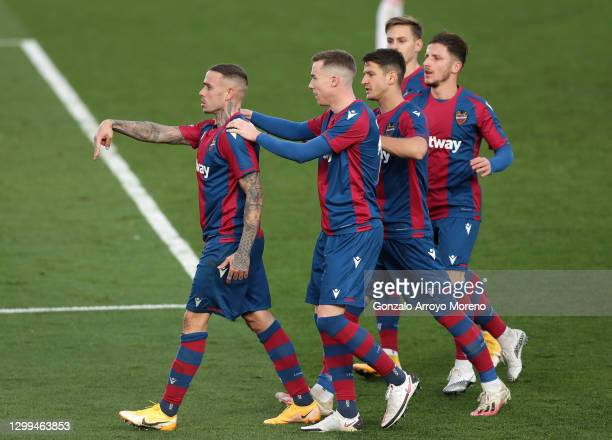 Roger of Levante UD celebrates with teammates after scoring his team's second goal during the La Liga Santander match between Real Madrid and Levante...